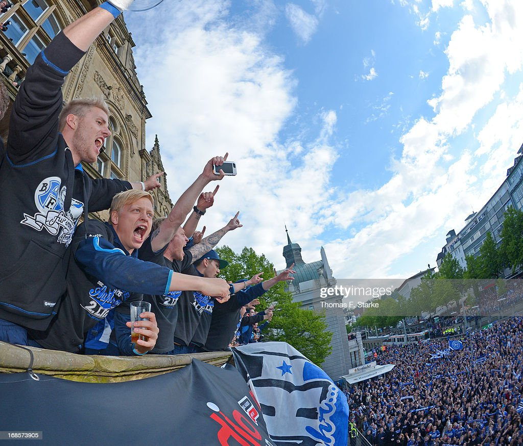 Felix Burmeister (L) and Manuel Hornig (2nd L) of Bielefeld celebrate with the supporters at the town hall after the Third League match between Arminia Bielefeld and VfL Osnabrueck at Schueco Arena on May 11, 2013 in Bielefeld, Germany.