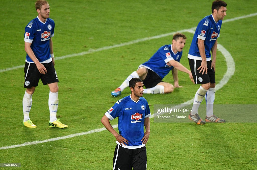 Felix Burmeister, Marcel Appiah, Sebastian Hille and Stephan Salger of Bielefeld look dejected during the Second Bundesliga Playoff Second Leg match between Arminia Bielefeld and Darmstadt 98 at Schueco Arena on May 19, 2014 in Bielefeld, Germany.