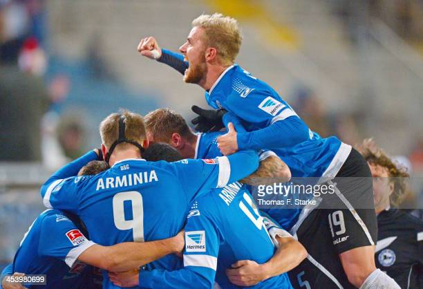 Felix Burmeister of Bielefeld celebrates on top of his teammates during the Second Bundesliga match between Arminia Bielefeld and Dynamo Dresden at...