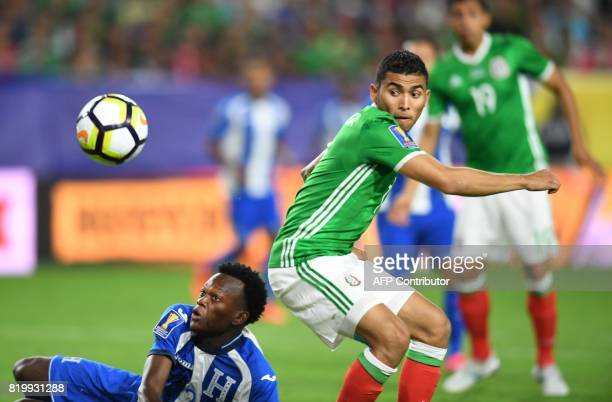 Felix Crisanto of Honduras battles Orbelin Pineda of Mexico during their quarterfinal CONCACAF Gold Cup match on July 20 2017 at the University of...