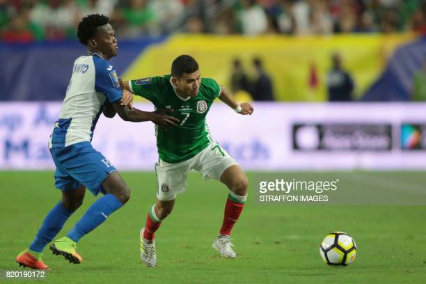 Felix Crisanto of Honduras compites the ball with Orbelin Pineda of Mexico during the CONCACAF Gold Cup 2017 quarterfinal match between Mexico and...