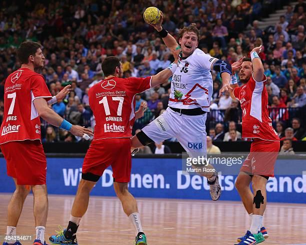 Felix Danner of Melsungen challenges for the ball with Jesper Nielsen of Berlin during the DHB Pokal handball semi final match between MT Melsungen...