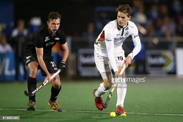 Felix Denayer of Belgium attempts to get away from Hayden Phillips of New Zealand during the Quarter final match between Belgium and New Zealand...
