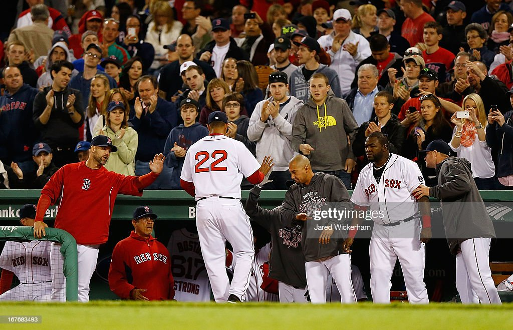 Felix Doubront #22 of the Boston Red Sox is congratulated by teammates in the dugout after being pulled from the game against the Houston Astros during the game on April 27, 2013 at Fenway Park in Boston, Massachusetts.