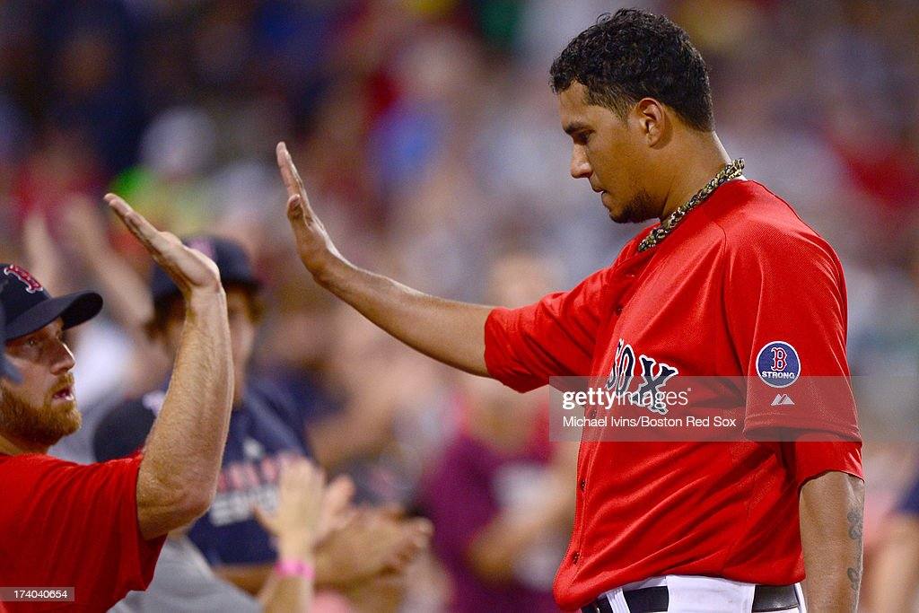 Felix Doubront #22 of the Boston Red Sox is congratulated by teammates after being pulled against the New York Yankees in the sixth inning on July 19, 2013 at Fenway Park in Boston, Massachusetts.