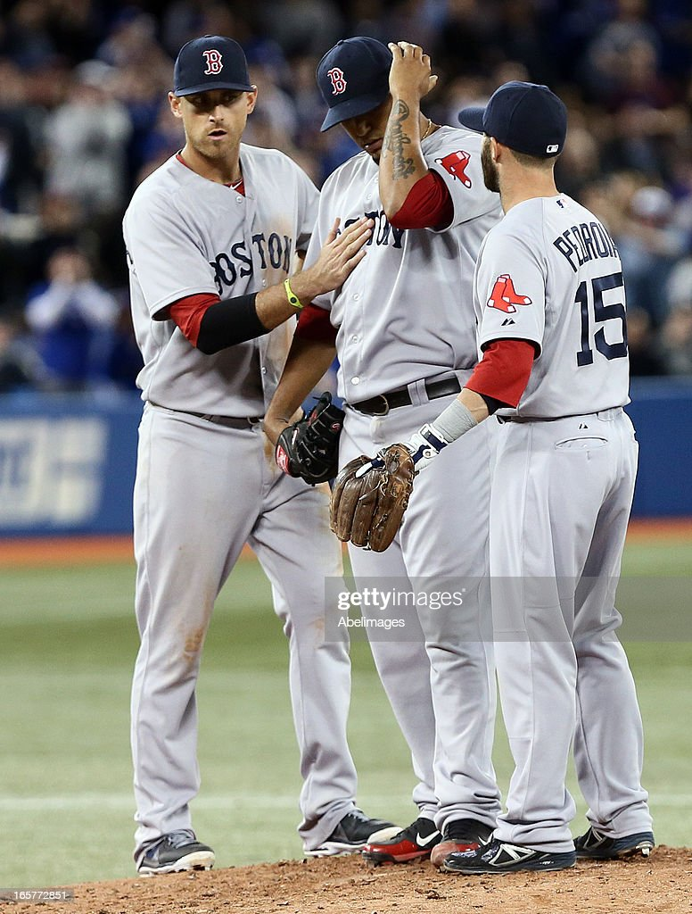 Felix Doubront #22 of the Boston Red Sox is consoled while being relieved from the game in the 6th inning against the Toronto Blue Jays during MLB action at the Rogers Centre April 5, 2013 in Toronto, Ontario, Canada.