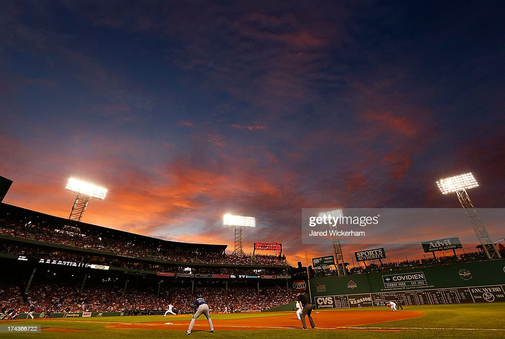 Felix Doubront #22 of the Boston Red Sox pitches against the Tampa Bay Rays as the sun sets over Fenway Park in the fourth inning during the game on July 24, 2013 at Fenway Park in Boston, Massachusetts.