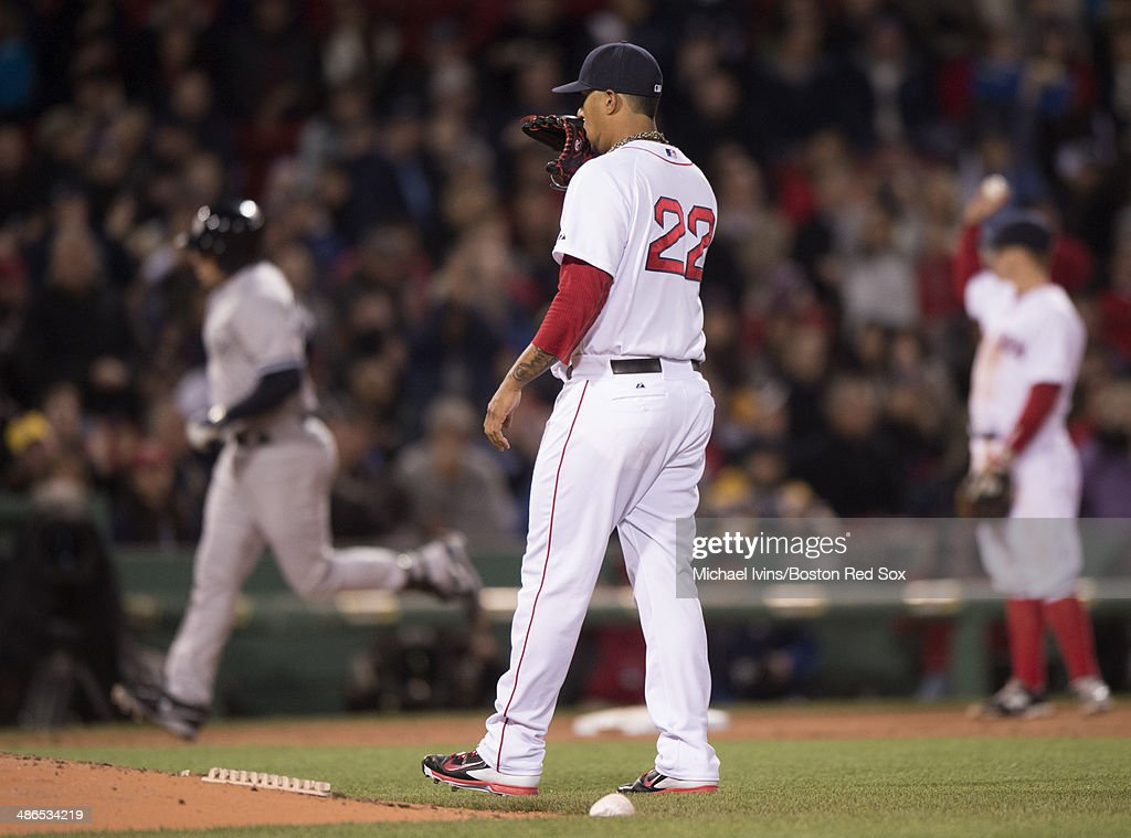 Felix Doubront #22 of the Boston Red Sox reacts after allowing a home run to Mark Teixeira #25 of the New York Yankees in the third inning at Fenway Park on April 24, 2014 in Boston, Massachusetts.