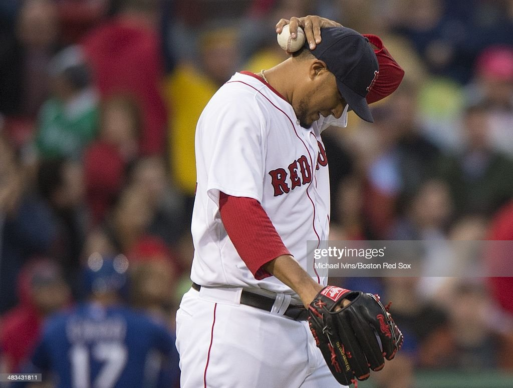 Felix Doubront #22 of the Boston Red Sox reacts after allowing an RBI double to Prince Fielder #84 of the Texas Rangers in the third inning at Fenway Park on April 8, 2014 in Boston, Masschusetts.
