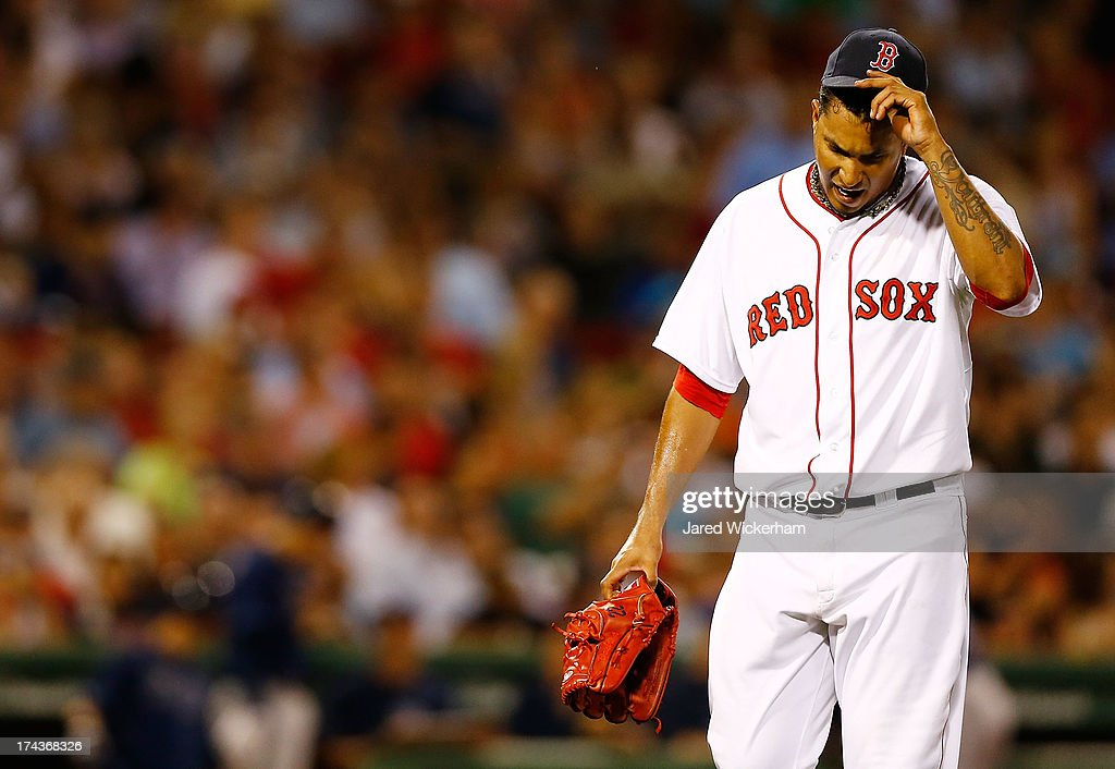 Felix Doubront #22 of the Boston Red Sox reacts after being pulled from the game in the 7th inning against the Tampa Bay Rays during the game on July 24, 2013 at Fenway Park in Boston, Massachusetts.