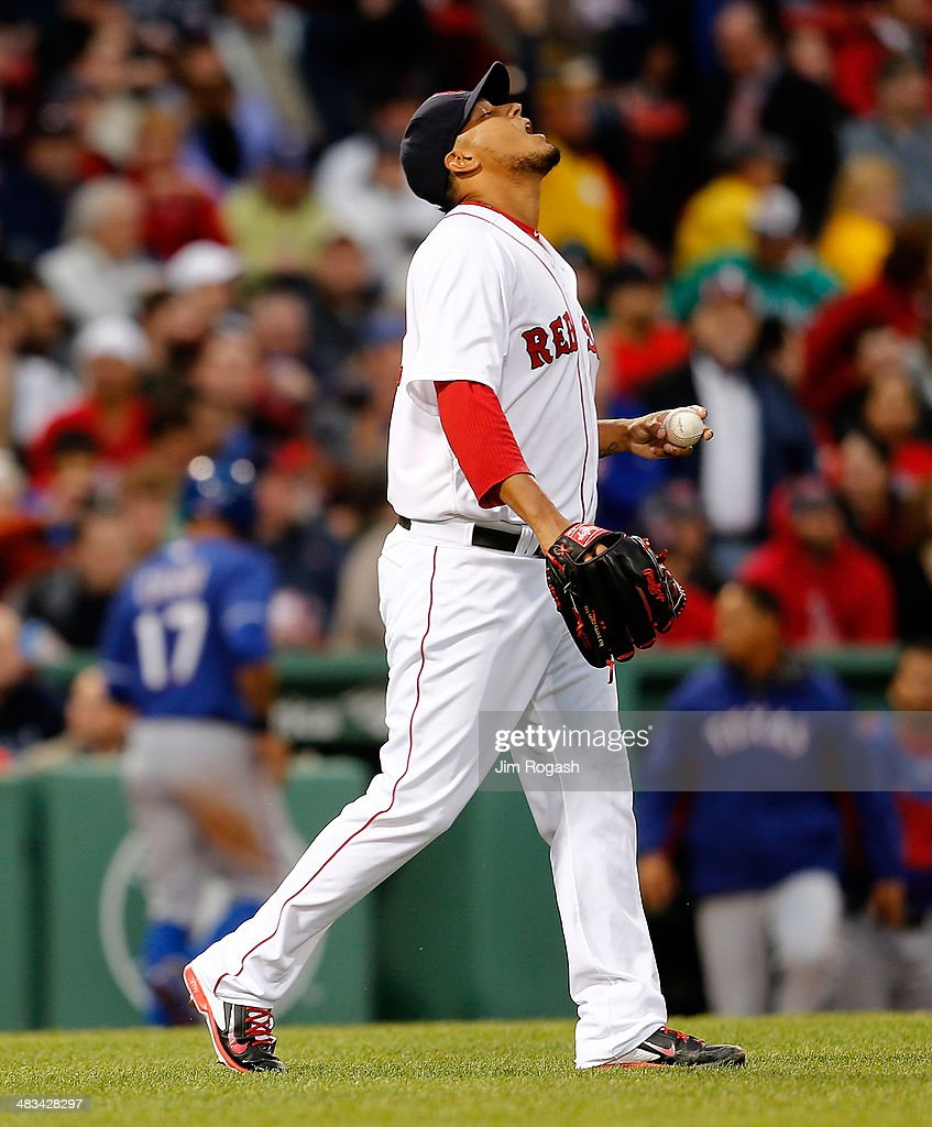 Felix Doubront #22 of the Boston Red Sox reacts after <a gi-track='captionPersonalityLinkClicked' href=/galleries/search?phrase=Shin-Soo+Choo&family=editorial&specificpeople=196543 ng-click='$event.stopPropagation()'>Shin-Soo Choo</a> #17 of the Texas Rangers scored on a double by Prince Fielder #84 in the 3rd inning at Fenway Park on April 8, 2014 in Boston, Massachusetts.