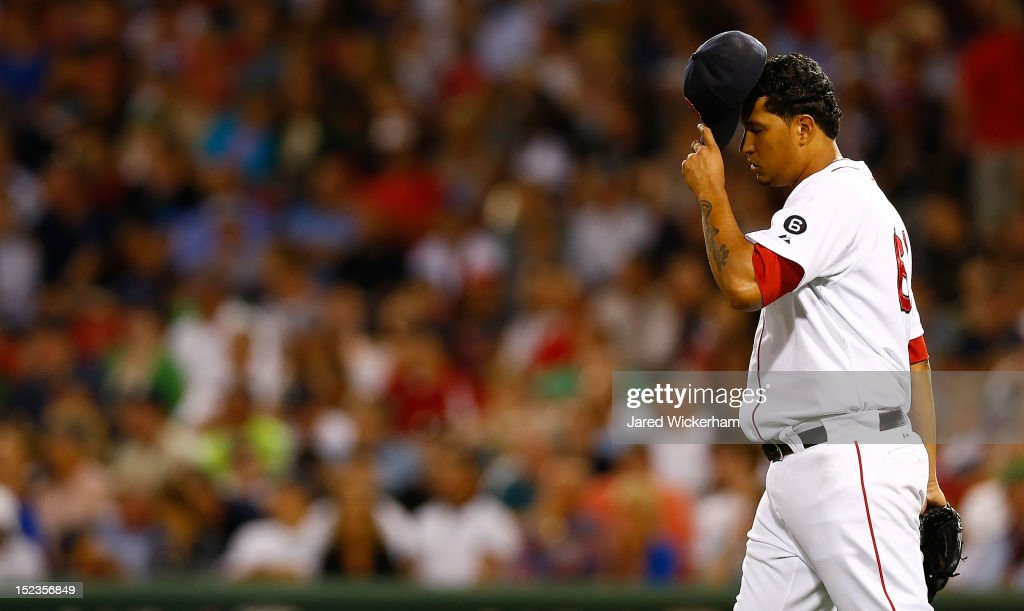 Felix Doubront #61 of the Boston Red Sox takes a moment in between pitches against the New York Yankees during the game on September 13, 2012 at Fenway Park in Boston, Massachusetts.