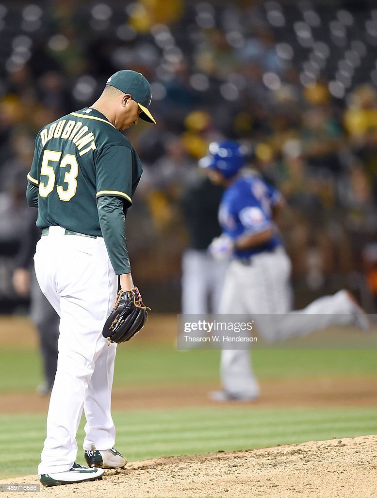 Felix Doubront #53 of the Oakland Athletics reacts after giving up a three-run homer to <a gi-track='captionPersonalityLinkClicked' href=/galleries/search?phrase=Adrian+Beltre&family=editorial&specificpeople=202631 ng-click='$event.stopPropagation()'>Adrian Beltre</a> #29 of the Texas Rangers in the top of the fifth inning at O.co Coliseum on September 23, 2015 in Oakland, California. The home run was the second three-run homer givin up by Doubront in the game.