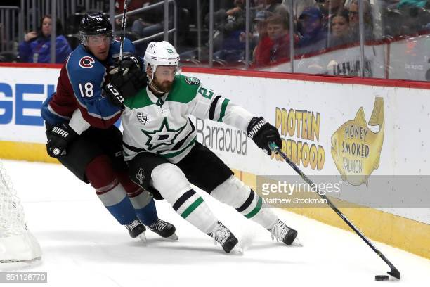 Felix Girard of the Colorado Avalanche fights for control of the puck against Greg Pateryn of the Dallas Stars at the Pepsi Center on September 21...