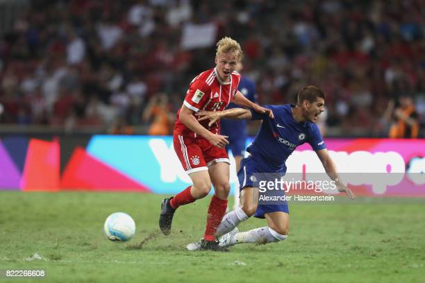 Felix Goetze of Bayern Muenchen battles for the ball with Alvaro Morata of Chelsea during the International Champions Cup 2017 match between Bayern...