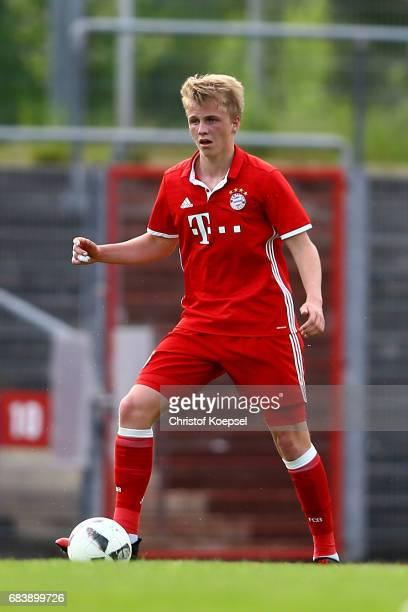 Felix Goetze of Bayern runs with the ball during the U19 German Championship Semi Final second leg match between FC Schalke and FC Bayern at...