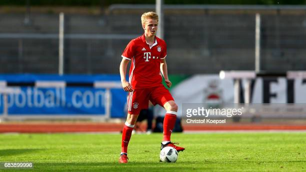 Felix Goetze of Bayern runs with the ball during the U19 German Championship Semi Final second leg match between FC Schalke and FC Bayern at...
