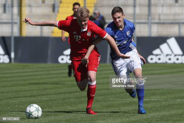 Felix Goetze of FC Bayern Muenchen fights for the ball with Benjamin Goller of FC Schalke 04 during the AJuniors semi final first leg German...