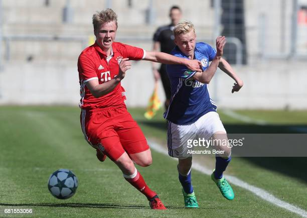Felix Goetze of FC Bayern Muenchen fights for the ball with Luke Hemmerich of FC Schalke 04 during the AJuniors semi final first leg German...