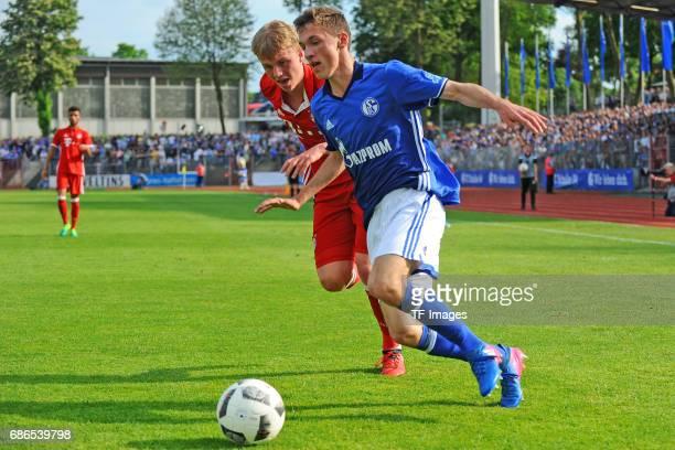 Felix Goetze of Munich and Benjamin Goller of Schalke battle for the ball during the U19 German Championship Semi Final second leg match between FC...