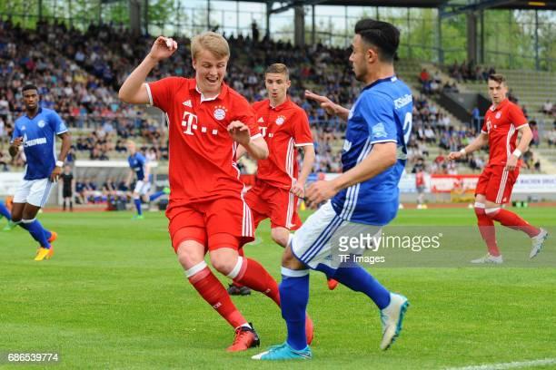 Felix Goetze of Munich and Erdinc Karakas of Schalke battle for the ball during the U19 German Championship Semi Final second leg match between FC...