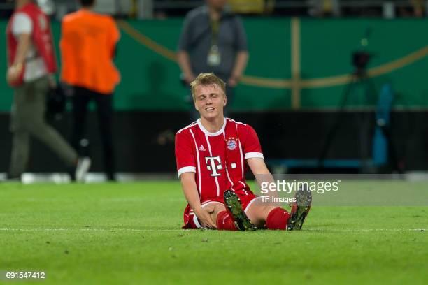 Felix Goetze of Munich on the ground during the U19 German Championship Final match between U19 Borussia Dortmund and U19 Bayern Muenchen at Signal...