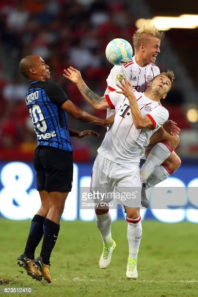 Felix Gotze and Niklas Dorsch of FC Bayern battels Joao Mario of FC Internazionale during the International Champions Cup match between FC Bayern and...