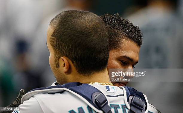 Felix Hernandez of the Seattle Mariners hugs his catcher Jesus Montero after pitching six scoreless innings in the game against the Houston Astros at...
