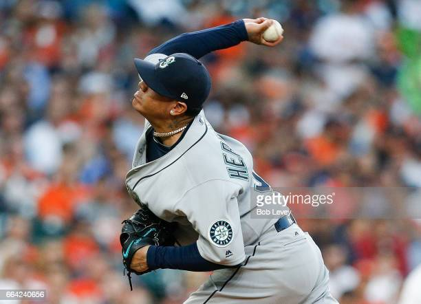 Felix Hernandez of the Seattle Mariners pitches in the first inning against the Houston Astros on Opening Day at Minute Maid Park on April 3 2017 in...