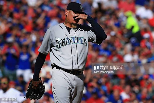 Felix Hernandez of the Seattle Mariners reacts after giving up a run against the Texas Rangers in the bottom of the fifth inning on Opening Day at...