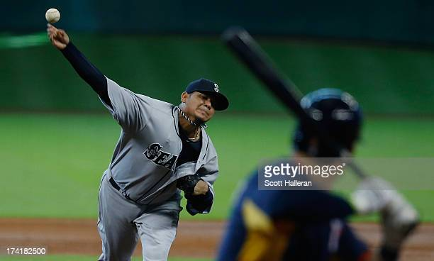 Felix Hernandez of the Seattle Mariners throws a pitch in the fifth inning against Brandon Barnes of the Houston Astros at Minute Maid Park on July...