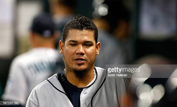 Felix Hernandez of the Seattle Mariners walks through the dugout after pitching six scoreless innings in the game against the Houston Astros at...
