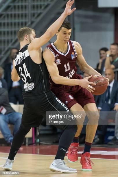 Felix Hoffmann of Wuerzburg and Vladimir Lucic of Bayern Muenchen battle for the ball during the easyCredit BBL Basketball Bundesliga match between...