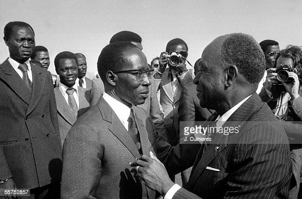 Felix HouphouetBoigny politician inhabitant of the Ivory Coast welcomed by Leopold Senghor statesman and Senegalese writer at the top of the African...