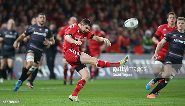 Felix Jones of Munster kicks the ball upfield during the European Rugby Champions Cup match between Munster and Saracens at Thomond Park on October...