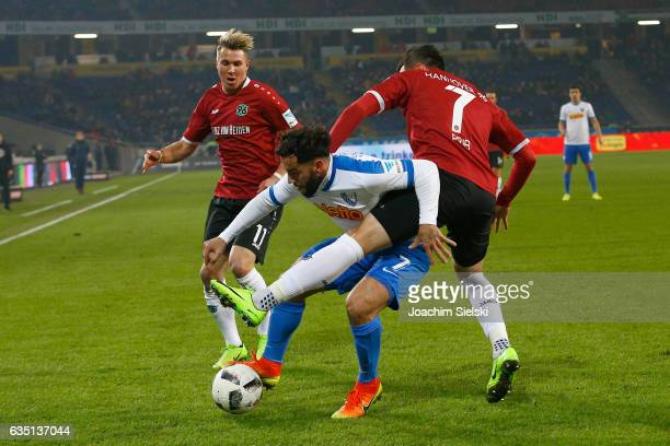 Felix Klaus and Edgar Prib of Hannover challenges Selim Guenduez of Bochum during the Second Bundesliga match between Hannover 96 and VfL Bochum 1848...