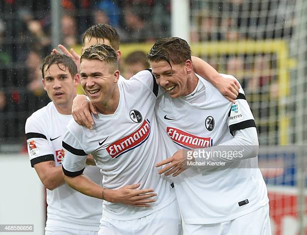 Felix Klaus and Mike Frantz of SC Freiburg celebrates opening goal of Frantz during the Bundesliga match between Sport Club Freiburg and 1 FC Koeln...