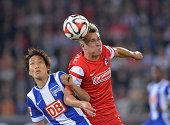 Felix Klaus of Freiburg challenges Genki Haraguchi of Hertha BSC during the Bundesliga match between SC Freiburg and Hertha BSC at Mage Solar Stadium...