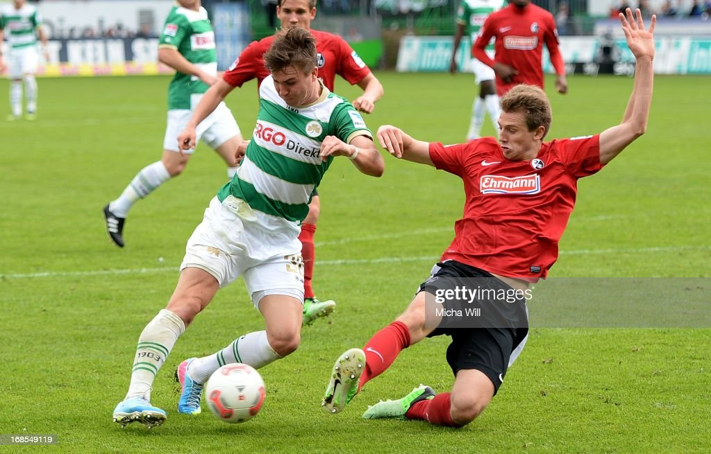 Felix Klaus (L) of Fuerth is challenged by Immanuel Hoehn of Freiburg during the Bundesliga match between SpVgg Greuther Fuerth and SC Freiburg at Trolli-Arena on May 11, 2013 in Fuerth, Germany.