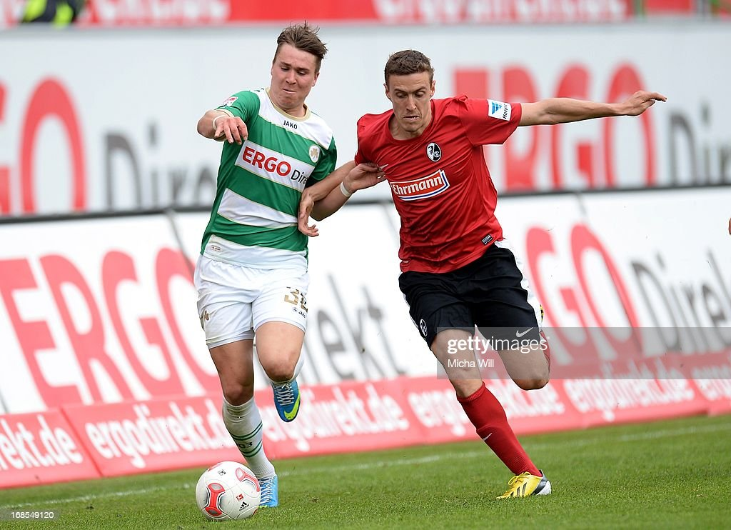 Felix Klaus (L) of Fuerth is challenged by <a gi-track='captionPersonalityLinkClicked' href=/galleries/search?phrase=Max+Kruse&family=editorial&specificpeople=3945507 ng-click='$event.stopPropagation()'>Max Kruse</a> of Freiburg during the Bundesliga match between SpVgg Greuther Fuerth and SC Freiburg at Trolli-Arena on May 11, 2013 in Fuerth, Germany.