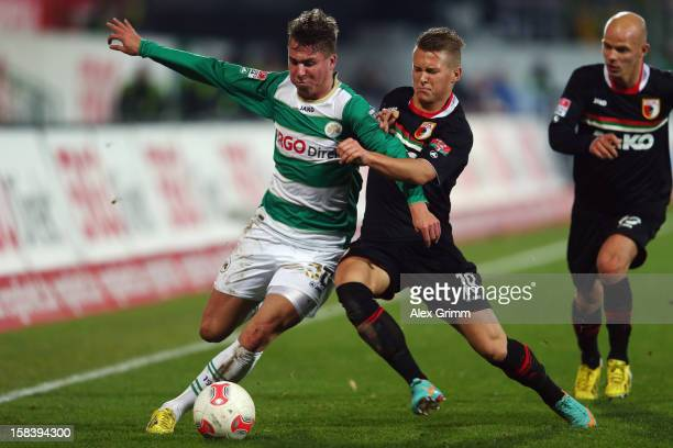 Felix Klaus of Greuther Fuerth is challenged by Matthias Ostrzolek of Augsburg during the Bundesliga match between SpVgg Greuther Fuerth and FC...