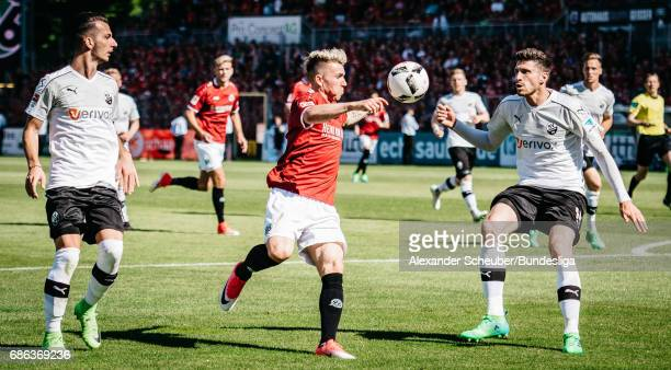 Felix Klaus of Hannover 96 in action against Tim Kister of Sandhausen during the Second Bundesliga match between SV Sandhausen and Hannover 96 at...