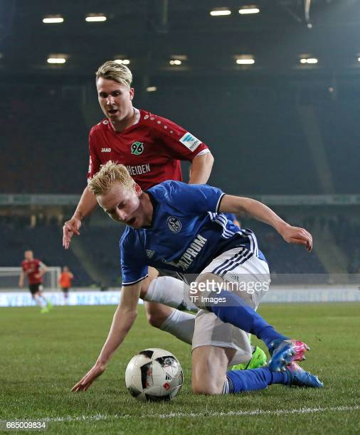 Felix Klaus of Hannover and Luke Hemmerich of Schalke battle for the ball during the friendly match between Hannover 96 an FC Schalke 04 at HDIArena...