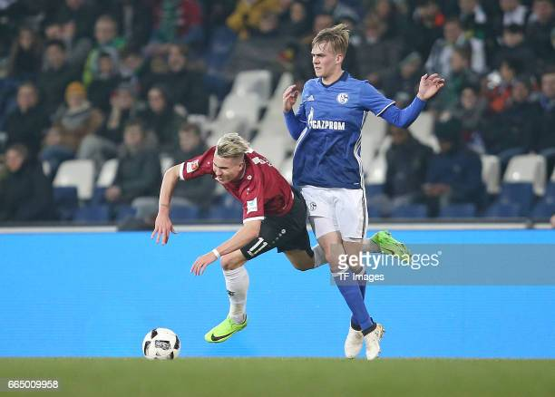 Felix Klaus of Hannover and Phil Halbauer of Schalke battle for the ball during the friendly match between Hannover 96 an FC Schalke 04 at HDIArena...