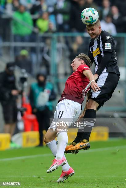 Felix Klaus of Hannover and und Nico Elvedi of Moenchengladbach battle for the ball during the Bundesliga match between Borussia Moenchengladbach and...