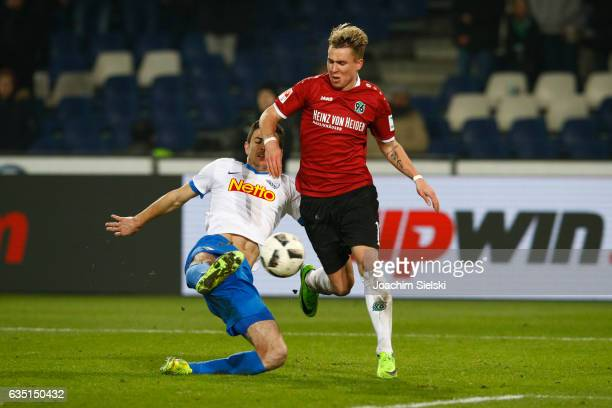 Felix Klaus of Hannover challenges Anthony Losilla of Bochum during the Second Bundesliga match between Hannover 96 and VfL Bochum 1848 at HDIArena...