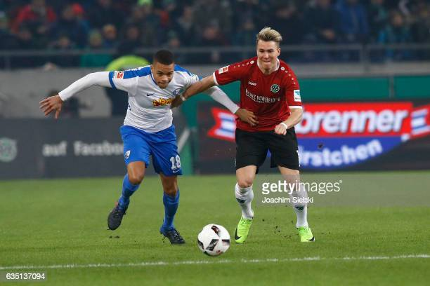Felix Klaus of Hannover challenges Jan Gyamerah of Bochum during the Second Bundesliga match between Hannover 96 and VfL Bochum 1848 at HDIArena on...
