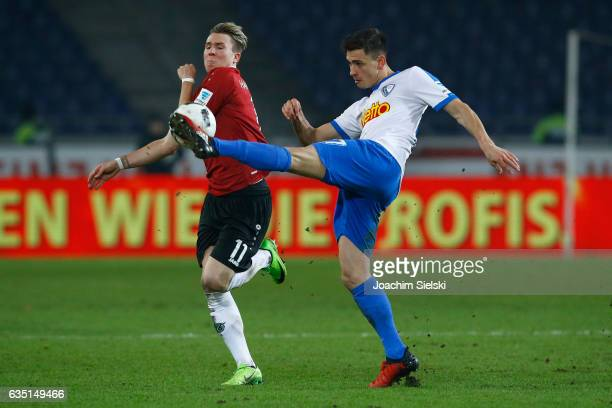 Felix Klaus of Hannover challenges Nico Rieble of Bochum during the Second Bundesliga match between Hannover 96 and VfL Bochum 1848 at HDIArena on...