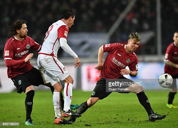 Felix Klaus of Hannover is challenged by Christoph Moritz of Kaiserslautern during the Second Bundesliga match between Hannover 96 and 1 FC...