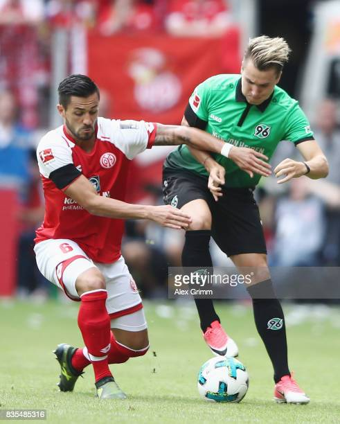 Felix Klaus of Hannover is challenged by Danny Latza of Mainz during the Bundesliga match between 1 FSV Mainz 05 and Hannover 96 at Opel Arena on...